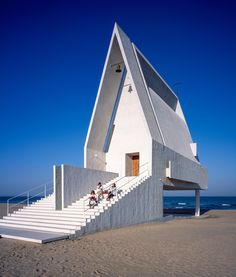 Seashore Chapel Beijing studio Vector Architects has built a concrete chapel on a Chinese beach, but raised it up above the sands so that seawater can wash underneath