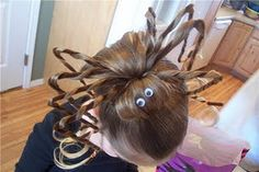 Spider Hairdo.  I want to have a little girl just so I can try this.
