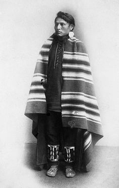glenbowmuseum     Blackfoot Man in Blanket    Image No: NA-1494-47     Title: Blackfoot man.     Date: [ca. 1886-1889]     Photographer/Illustrator: Ross, Alexander J., Calgary, Alberta.     Remarks: Wearing blanket     Subject(s): Blackfoot - Clothing