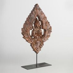 One of my favorite discoveries at WorldMarket.com: Painted Acacia Wood Carving with Stand
