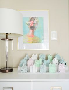 Pastel Christmas village DIY project for the holidays: so easy, cheap, and fun! Click through for all the details (you won't believe the befores!)