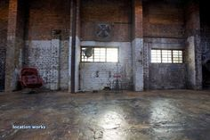 Large, gritty warehouse studio in north London, with brick walls, corrugated iron, props, and dressing rooms.