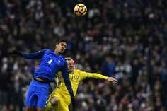Sweden's forward John Guidetti (R) heads the ball with France's defender Raphael Varane during the 2018 World Cup group A qualifying football match between France and Sweden at the Stade de France in Saint-Denis, north of Paris, on November 11, 2016. / AFP / MIGUEL MEDINA