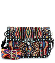 Valentino - Valentino Garavani Santeria Guitar Rockstud Rolling bead-embellished leather shoulder bag - Valentino's Santeria line this season was inspired by the vibrant culture of the Caribbean island of Cuba, and the results are stunning. Crafted from textured black leather, the designer's Guitar Rockstud Rolling shoulder bag features the line's classic studs and turquoise cabochons. As a colourful update, thousands of tiny wooden beads coat the front of this bag, while an intricately…