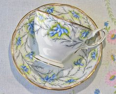 Royal Albert bone china tea set in Heather Bell pattern with blue flowers, green foliage, and gold trim