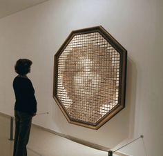 """Wooden Mirror"" (1999) by Daniel Rozin. 830 wood pieces, motors, video camera, control electronics, custom software, microcontroller. 61 x 70 x 8"" / 155 x 178 x 20 cm, edition of 6. #art #sculpture #technology"