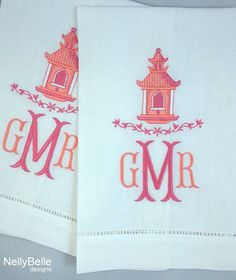 The pagoda design is monogrammed in shades of coral and pink on linen guest towels. NellyBelle Designs