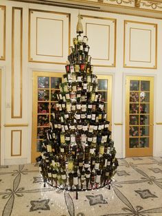 One of our 10ft Wine Bottle Christmas Trees on display in the lobby of Paris Casino & Hotel in Las Vegas