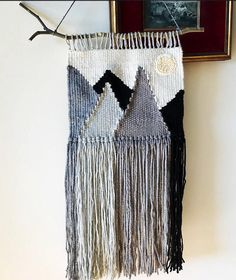 Handwoven wall hanging - mountain range in shades of gray with embroidered sun.  Measures 10 x 20