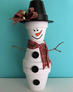 Best 12 Hand-Painted Clay Pot Snowman Figurine Shelf-sitter, featuring a Handmade Bow with Bells – Stands approximately 12 inches tall, paint protected by 2 coats of clear, matte varnish. Perfect shelf décor for the Winter season Christmas Clay, Christmas Crafts For Kids, Diy Christmas Gifts, Holiday Crafts, Christmas Ornaments, Snowman Ornaments, Christmas Tree, Flower Pot Crafts, Clay Pot Crafts