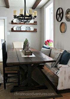 Love this farmhouse table with a pew, plate rack, farmhouse chandelier - everything!