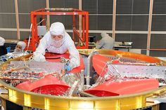 Thermal technician adds the final touches to electrical wires in Propulsion Module #1.