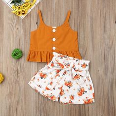 Toddler girl fashion spring white and orange floral shorts with bow tie waist paired with an orange button detail top . Girls Summer Outfits, Little Girl Outfits, Little Girl Fashion, Short Outfits, Cute Outfits, Little Girl Clothing, Little Girl Summer Dresses, Kid Outfits, Outfit Summer