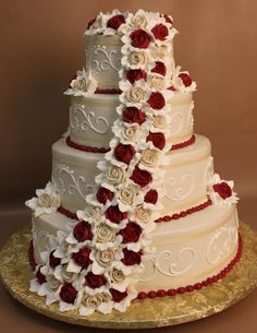 Ivory buttercream frosting, white open scroll with dots. Ivory eyelet ribbon above and below with white pearl border at the base. Cascade of ivory and burgundy