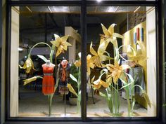 #UniversityVillageSeattle #Anthropologie lillies on massive scale craft paper flowers window display