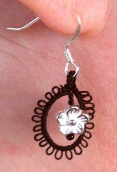 Tatting: Tatted Earrings.      Cool, this gives me an idea for the skull beads that i have...