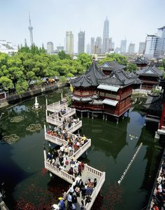 Yu Garden has a famous bridge of zigzag called the bridge of nine turns. Each turn offers visitors scenery from different angles.