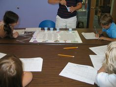 Get Cooking with Chemistry 2014 - Kids recording reactions.  July 22, 2014.