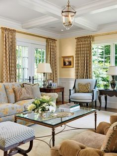 Love the combination of formality and comfort in this living room.  Beautiful colour scheme.
