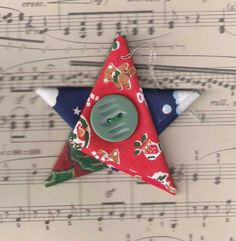 A set of five Christmas tree ornaments in the shape of stars, created from a variety of folded Christmas fabrics in red, blue, green, white, silver and gold. They have a silver hanging loop, and a red or green vintage button in the centre. Each star measures approximately 7.5cm (3in) tall/wide and the hanging loop is approximately 4cm (1.5in) long.  This listing is for the five stars pictured - I have more available, so if youd like particular colours, please contact me and Ill create a…