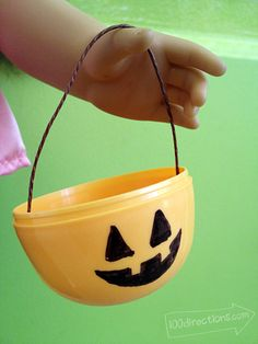 Jack-o-lantern treat bucket for dolls plus a printable for a Halloween banner
