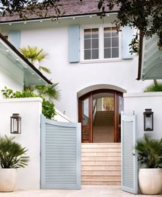 The entrance stairway of this Windsor, Florida, home leads to an outdoor courtyard. Beach Cottage Style, Coastal Cottage, Beach House Decor, Coastal Living, Coastal Style, Coastal Bedrooms, White Cottage, Cottage House, Coastal Homes