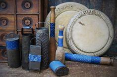 antiques wrapped in blue calico. www.catspawprimitives.blogspot.com
