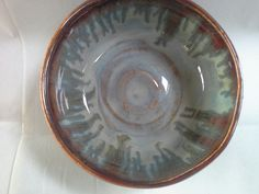 Porcelain pot.  Seaweed,  oatmeal and ancient Jasper on the rim.  Great