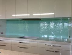 Aqua textured glass Kitchen splashback. #kitchensplashbacks