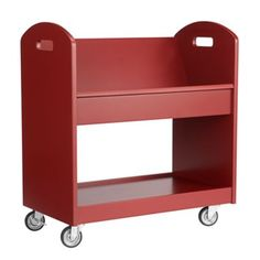 This book cart lives in our upstairs hall and holds a lot of books and toys - and the nightlight.   Local Branch Library Cart (Tomato)  | The Land of Nod