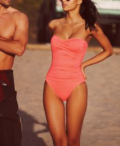 Love the flattering sweetheart neckline. This slimming twist front bandeau one-piece swimsuit is perfect for a day by the pool.