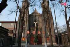 """St. Michael's Church (also known as French Legation Church and Dongjiaominxiang Church) in Beijing posts up a banner that reads """"Merry Christmas"""" in Chinese on Dec. 25, the Christmas Day. St. Michael's Church is mostly famous for the statue of Michael the Angel"""