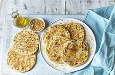 These easy flatbreads use just three storecupboard ingredients and can be whipped up in under 10 minutes. See more Side dish recipes at Tesco Real Food. Indian Food Recipes, Vegetarian Recipes, Cooking Recipes, Healthy Recipes, Side Dish Recipes, Great Recipes, Bread Winners, Tesco Real Food, Indian Dishes