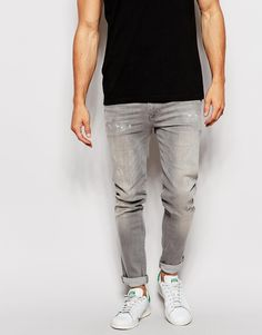 """Jeans by ASOS Firm-stretch denim Distressed finish Regular rise Zip fly Skinny fit - cut closely to the body Machine wash 99% Cotton, 1% Elastane Our model wears a 81cm/32"""" regular and is 185.5cm/6'1"""" tall"""
