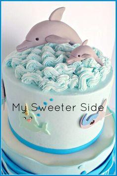 Dolphins cake topper on buttercream waves