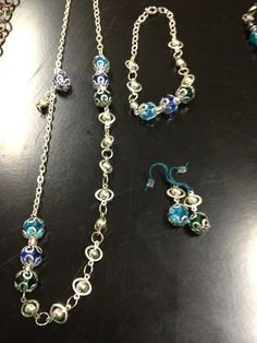 Teals Blues and Greens by thefalconandtheraven on Etsy, $26.99
