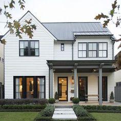 White siding exterior with black window mullions Black Trim Exterior House, White Farmhouse Exterior, White Siding, House Paint Exterior, Farmhouse Design, Exterior Design, Coastal Farmhouse, House Siding, Facade House