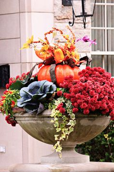mums, ornamental kale, a pumpkin, and an urn... HELLO FALL!