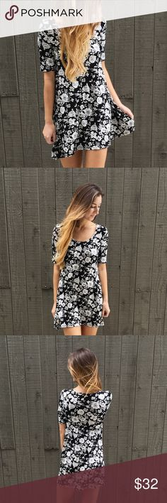 | new | short sleeve floral dress offers welcome new with tag black and white floral dress with short sleeves. modeling size small. •670643• Dresses Mini