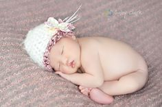 Newborn Hat with Flower and Feather Accents. $28.00, via Etsy.