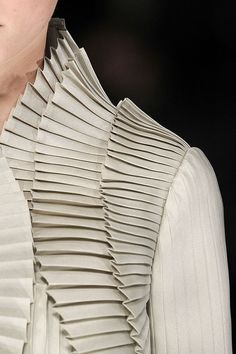 Shoulder Ruffles in White, known as Accordion Pleats ....