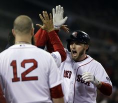 Boston Red Sox's Stephen Drew is congratulated after hitting a home run during the fourth inning of Game 6 of baseball's World Series agains...
