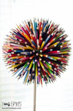 Pencil craft flower in a paint bucket colored pencil craft flower made