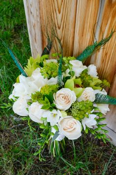 Natural white and green bridal bouquet with bupleurum, vendela roses, white freesia, green cymbidum orchids & peacock swords! Created by: Flowers by Janie- Calgary and Canmore wedding florist www.flowersbyjanie.com