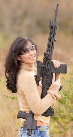 Great Looking Gals and Awesome Firearms...Google Image Result for http://www.ushanka.us/blog/images/gun11.5.10.jpg