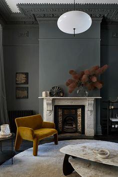 Dark interior with a wood panelled kitchen - via Coco Lapine Design blog