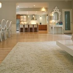 Benjamin Moore Revere Pewter seen here with light floors, white trim, midtone wood cabinets...similar to your great room...