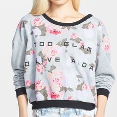 "GONE 11/25 MINKPINK Too Glam  sweatshirt Let everyone know where you stand in this stylishly oversized sweater emblazoned with a sassy inscription. Contrast black ribbing accents the heathered floral print, while dropped shoulders add trend-right detail. 20"" length  65% polyester, 35% cotton. Machine wash cold, line dry. By MINKPINK MINKPINK Tops Sweatshirts & Hoodies"