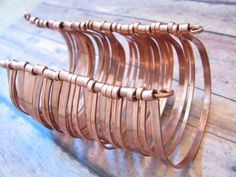 Copper Cuff Bracelet - Multiple Layers Bangles Bracelet - Nomad Gypsy - Handmade Copper Jewelry. $90.00, via Etsy.