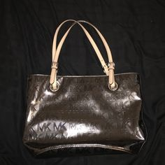 Michael Kors MK Tote Shoulder Bag – Nickel -Authentic Michael Kors Nickel Mirror Metallic Monogram with Tan Leather Trim 10″ Drop Double Leather Straps with Buckles Measures : 14.5″ / 11″ (L) x 10.5″ (H) x 6.5″ (D) Magnatic Snap Closure. Back Slip Pocket Michael Kors signature lining with one zippocket & 4 slip pockets -New without tags! NEVER BEEN USED Michael Kors Bags Totes
